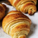 A detailed shot of a croissant.