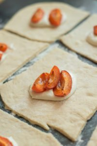 three roasted apricot quarters on a filling of curd cheese.